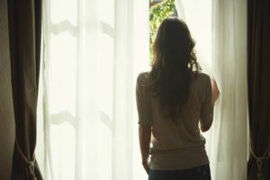 635935081958289483-916790310_woman-looking-out-window